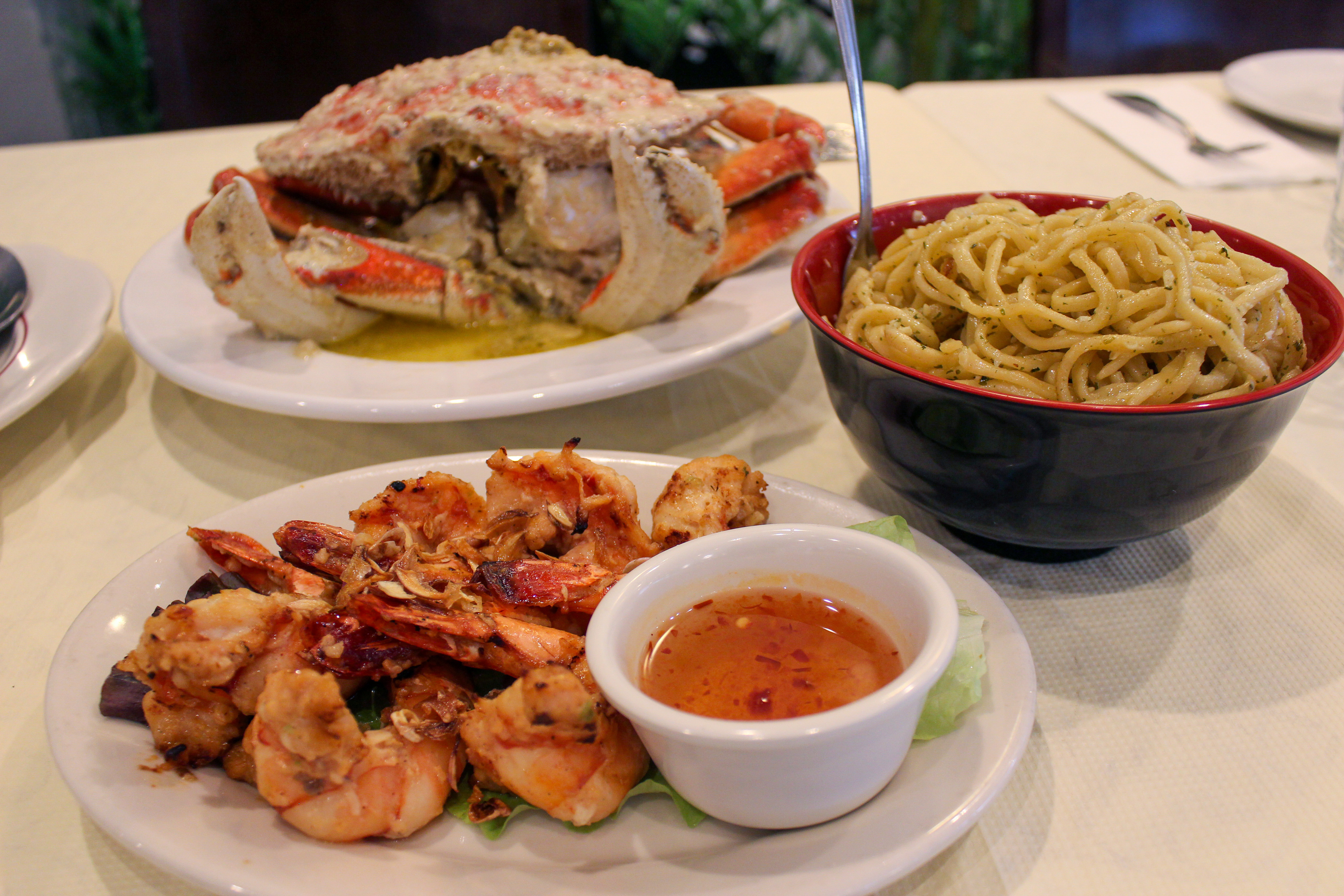 tiger prawns, garlic noodles, and roasted crab